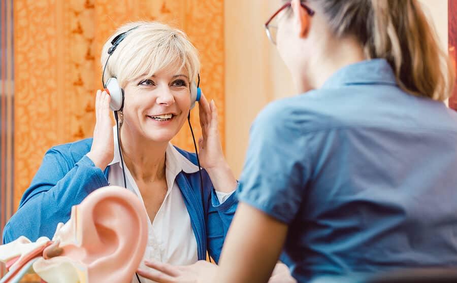 deaf woman takes a hearing test